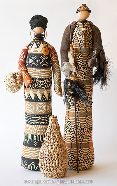 Two African-inspired fabric Stump Dolls made using handprinted fabric from Zimbabwe
